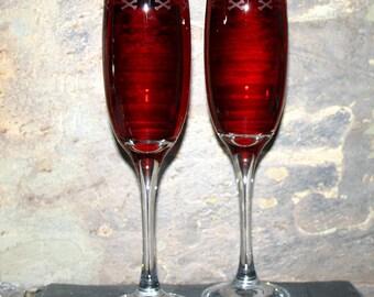 Skull Border - Pair of exclusive design skull & crossbone bordered Champagne glasses