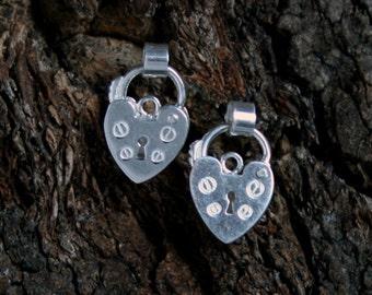 Discrete Unisex Slave Padlock stud Earrings. Padlock BDSM earring. Sterling silver. Heart shape small padlock. Buy singly or by the pair.