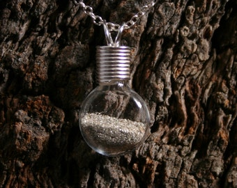 Silver Dust Wishes ~ 'Make a Wish' Pendant ~ Hand blown glass & sterling silver pendant with real silver dust sealed inside. Wishing bottle