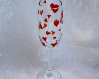 Love Heart - Red and Gold - An exclusive design, hand painted, champagne glass featuring a multitude of red hearts outlined in gold.