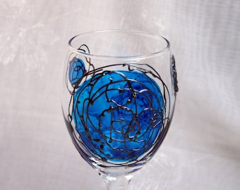 Galaxy - Blue and Pewter - An exclusive design, hand painted, wine glass featuring blue 'planets' swirled with raised pewter 'orbit trails'