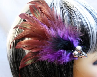 Exclusive 'Purple plus Raven' hair grip / fascinator in Purple and pinky red, with hints of green and a center of black.