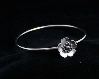 Floating rose bangle 'Wild Rose' Traditionally hand made. Satin finish roses. Fully UK Hallmarked Sterling Silver. Medium  67mm diameter.