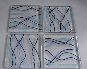 Fused glass coasters. 'Serpentine - Water'  Turquoise, Teal & Dark Blue on a clear base. Squiggly coasters. Choose 2 or 4. Can be customized