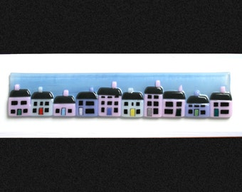 """Fused glass painting 'The Promenade' A row of pastel cottages, set against a hand painted blue summer sky on a white frame 34x10cm (13.5x4"""")"""