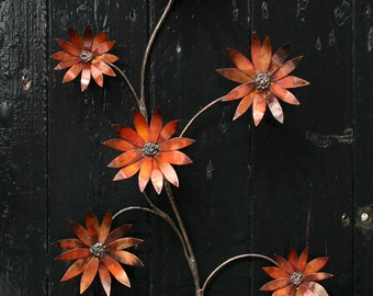 Copper flowers - a wall hanging spray of multi-hued copper flowers.