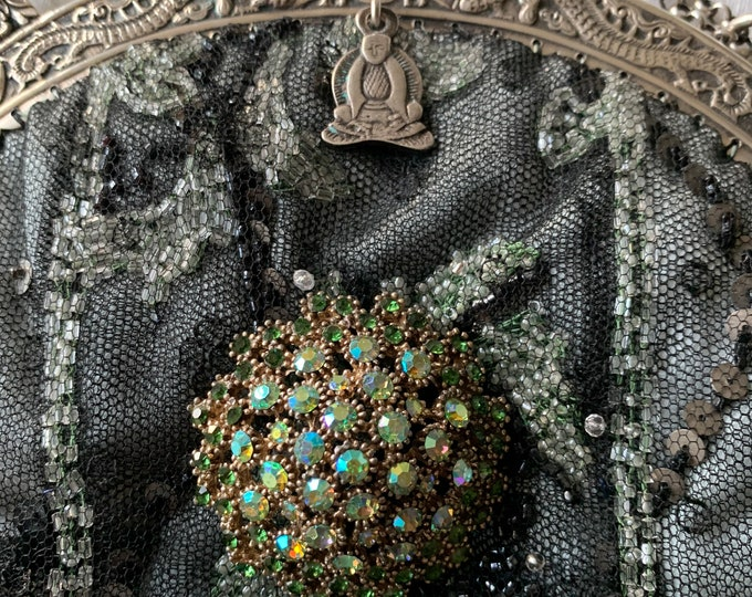 Antique silver handle beaded bag .