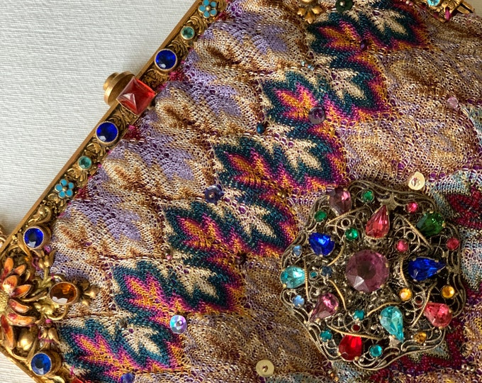 Antique enamel and jewelled purse frame with woven silk bag.