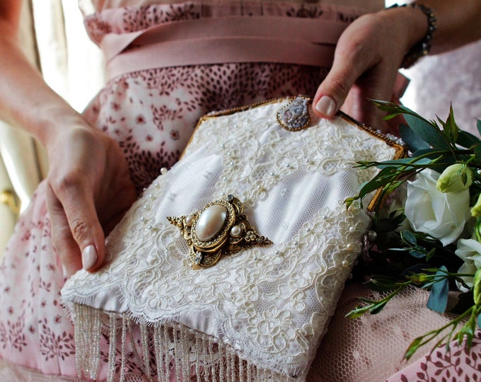 Antique 1940 micro beaded purse frame UpCycled and remade in ivory hand beaded lace .