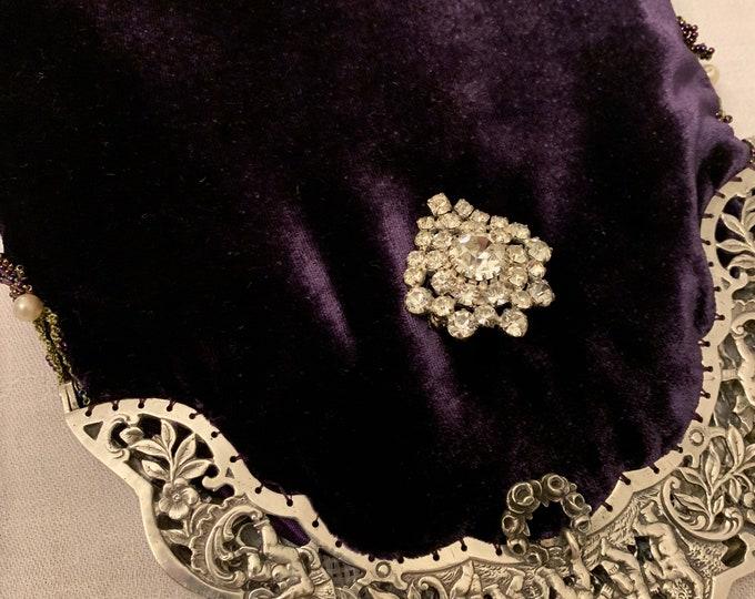 Antique silver cherub framed purple silk velvet evening bag .