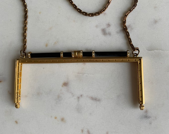 Antique black and gilt purse frame with pearls