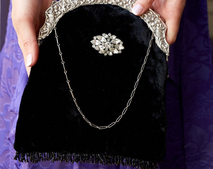 Antique 1940 silver plate handled up cycled black silk velvet purse with vintage rhinestone brooch.