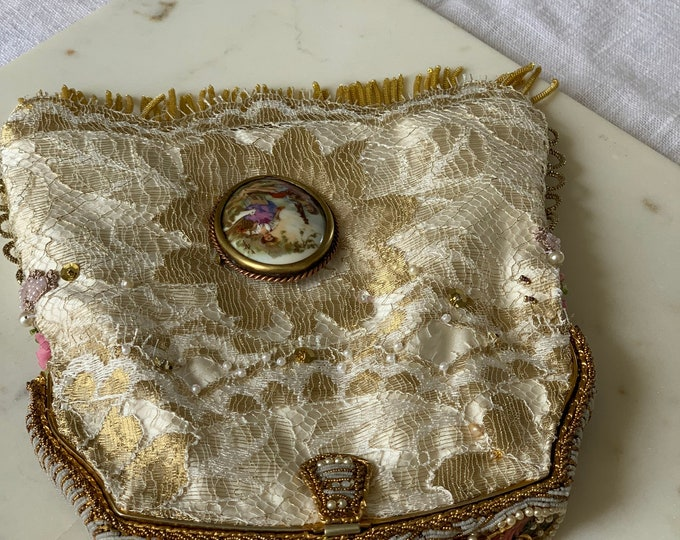 Antique enamel and finely beaded purse frame UpCycled and remade in gold and ivory hand beaded lace .