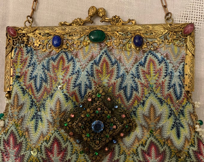 Antique gilt jewelled handled oriental style evening bag.