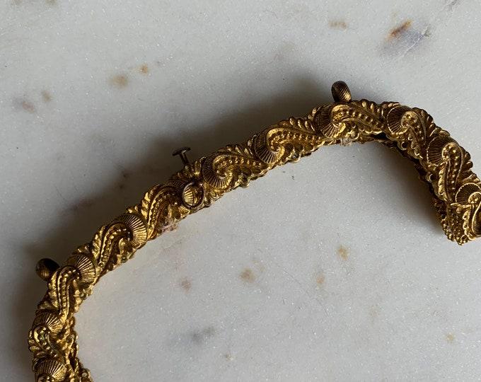 Antique engraved gilt purse frame