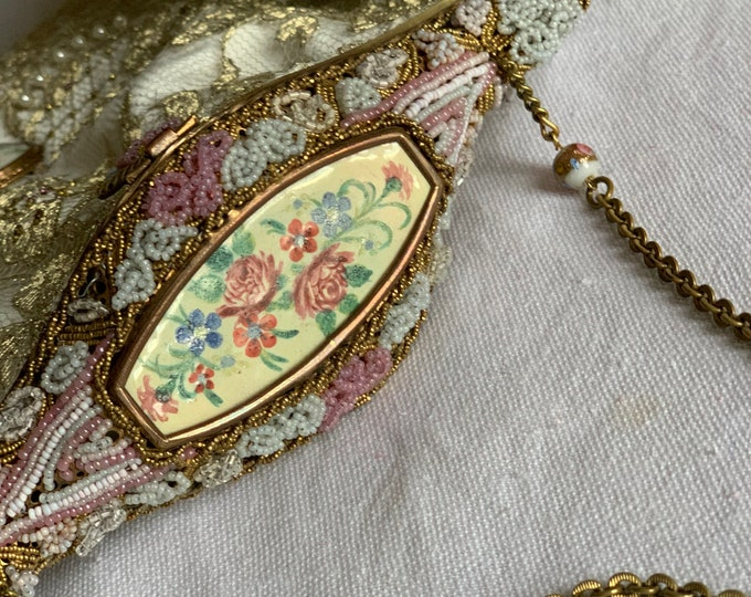 Antique beaded purse frame with hand painted inset on gold lace evening purse