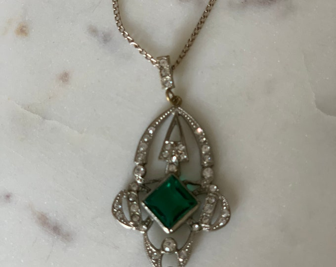 Art Deco rhinestone and green jewelled Silver plate pendant .