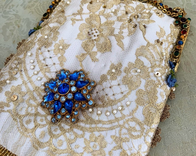 Magnificent jewelled gilt purse frame dating from around 1940 remade with french gold lace over silk .