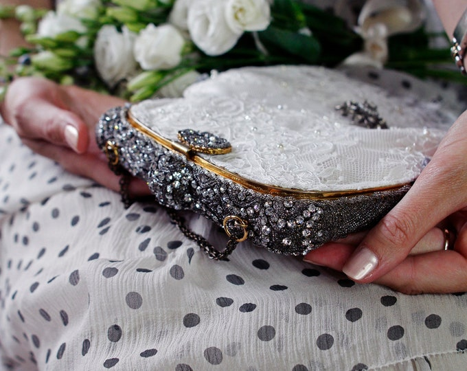 Antique 1940 s rhinestone frame  Up cycled and remade in hand beaded french lace and vintage Czech brooch .