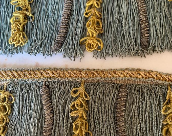 Antique passementerie fringing . Beautiful Aqua coloured fringing with metallic and silk detail .