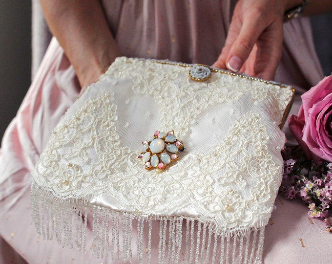Antique beaded and enamel purse frame remade in ivory hand beaded lace .