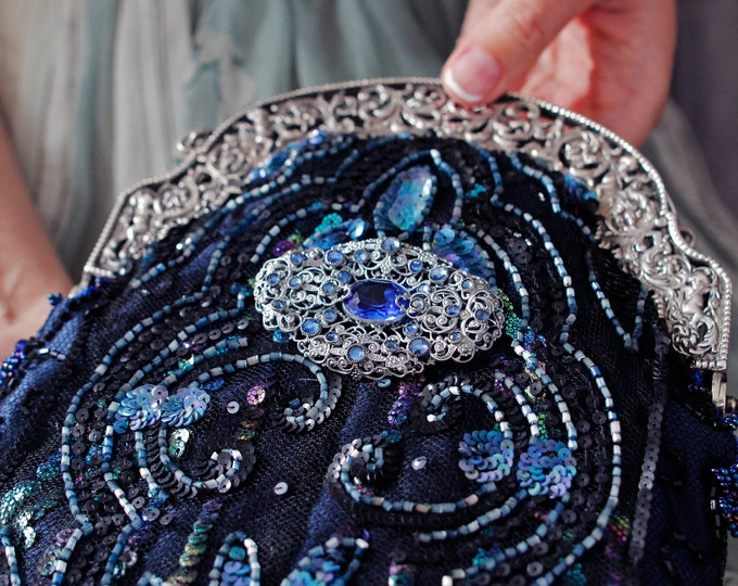Antique 1920 s  French hallmarked silver frame  UpCycled and remade in genuine antique blue beading over navy silk and vintage brooch .