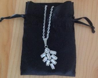 Rhinestone pendant on silver chain