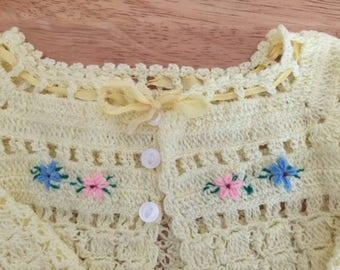 INFANT SWEATER, 3 - 6 mos, pale yellow hand-knit or crotched, embroidered flowers across front, Unisex and a deal of a price.
