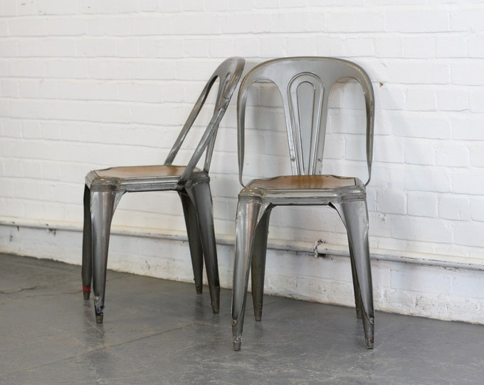 Pair Of Industrial Stacking Chairs By Fibrocit Circa 1930s