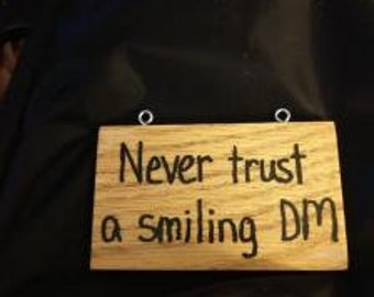Never Trust a Smiling DM - Hand-Burned Wooden Sign