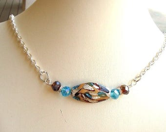 Lamp work necklace, beaded necklace, teal and browns, silver chain.