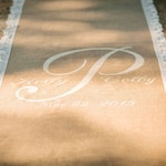 30 ft custom burlap runner with monogram & lace border. With NON-SLIP backing additional 35.00