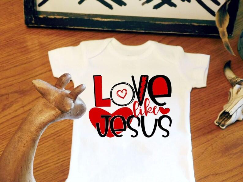 8a3414988 Valentines Day Bodysuit Love Like Jesus Religious Baby   Etsy