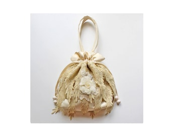 94e0555953 A draw string bag in cream satin   gold lace