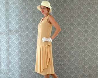 153c498cc8d 1920s-inspired flapper dress in pale marigold with drape and bow