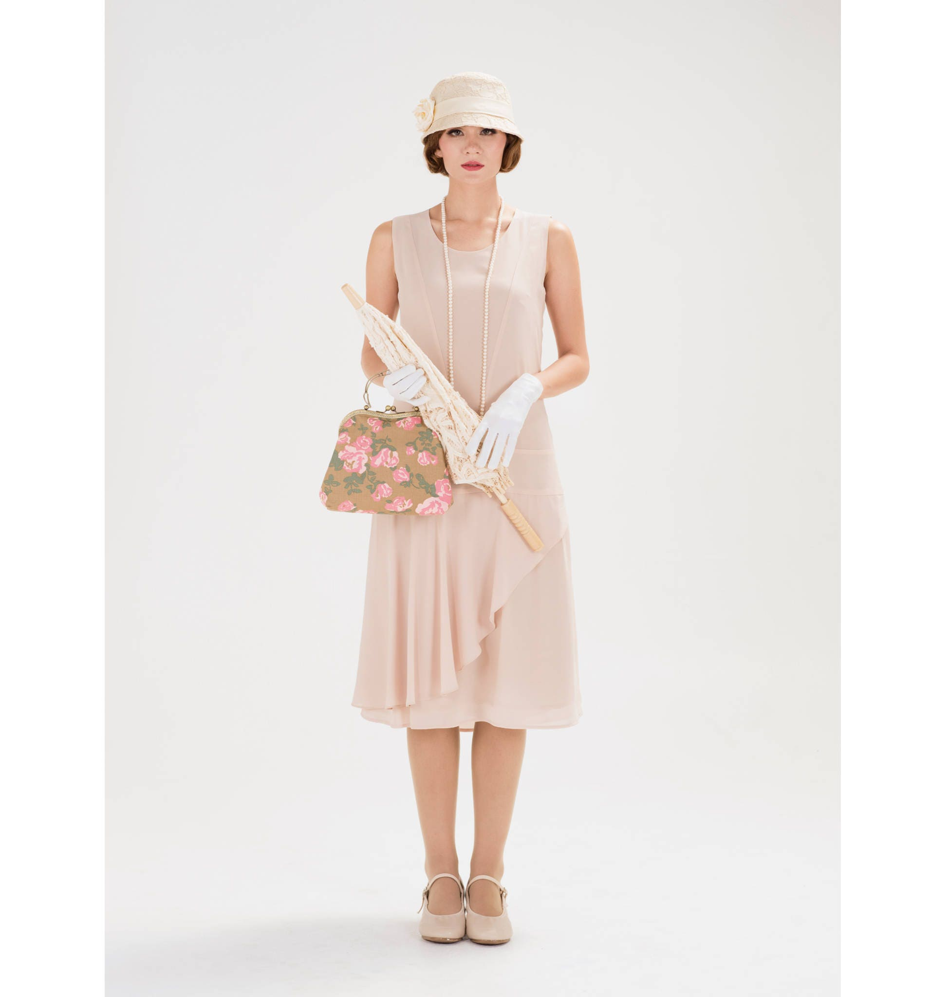 Nude jazz age flapper dress with a ruffled skirt detail ...