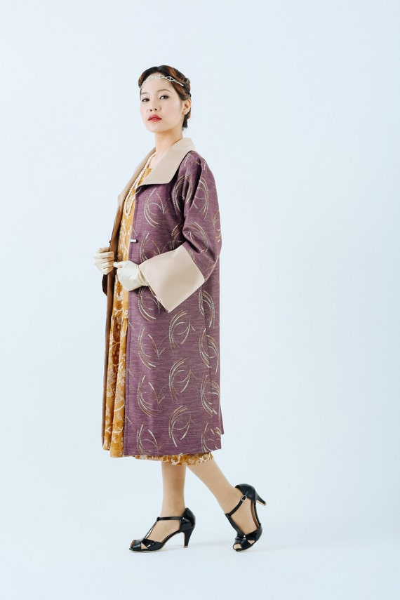 History of 1920s Coats, Furs and Capes 1920s Great Gatsby coat in mauve and beige colors purple flapper coat Miss Fisher coat purple flapper jacket art deco fashion  laviedelight $155.00 AT vintagedancer.com