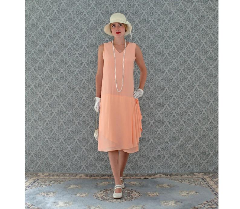60f0e0b0668 Sweet peach Great Gatsby dress with drape and bow Roaring 20s