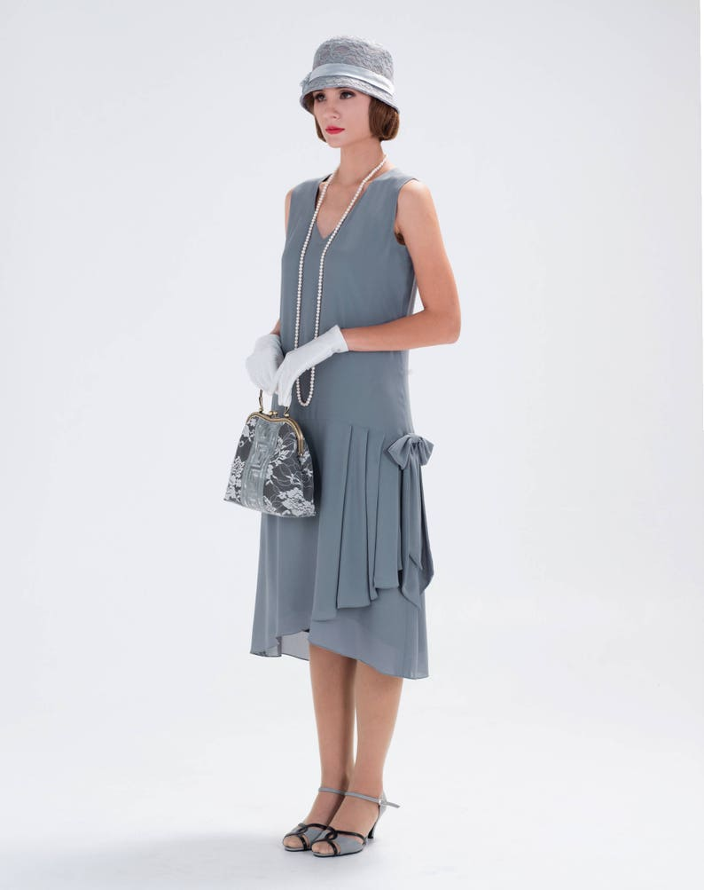 1920s Fashion & Clothing | Roaring 20s Attire 1920s-inspired flapper dress in grey with drape and bow 1920s fashion Great Gatsby dress Downton Abbey dress high tea dress 20s dress $130.00 AT vintagedancer.com