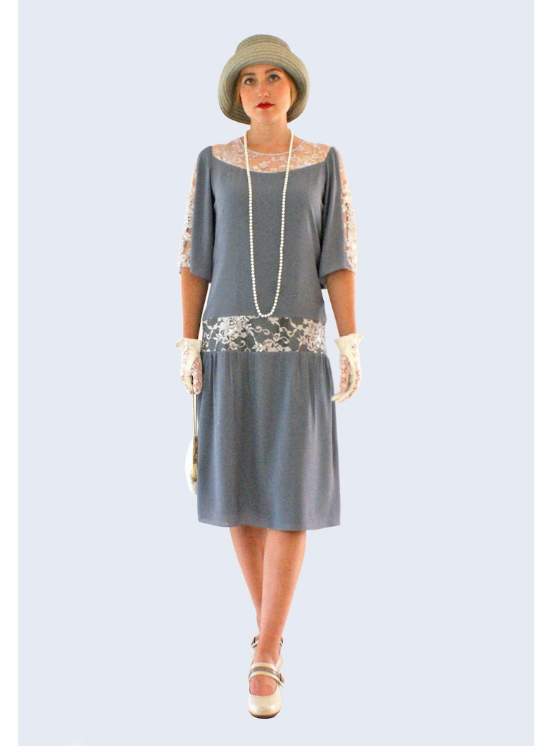 1920s Day Dresses, Tea Dresses, Mature Dresses with Sleeves Grey Great Gatsby dress with elbow-length sleeves 1920s dress flapper costume Charleston dress Roaring 20s fashion Downton Abbey dress $112.00 AT vintagedancer.com