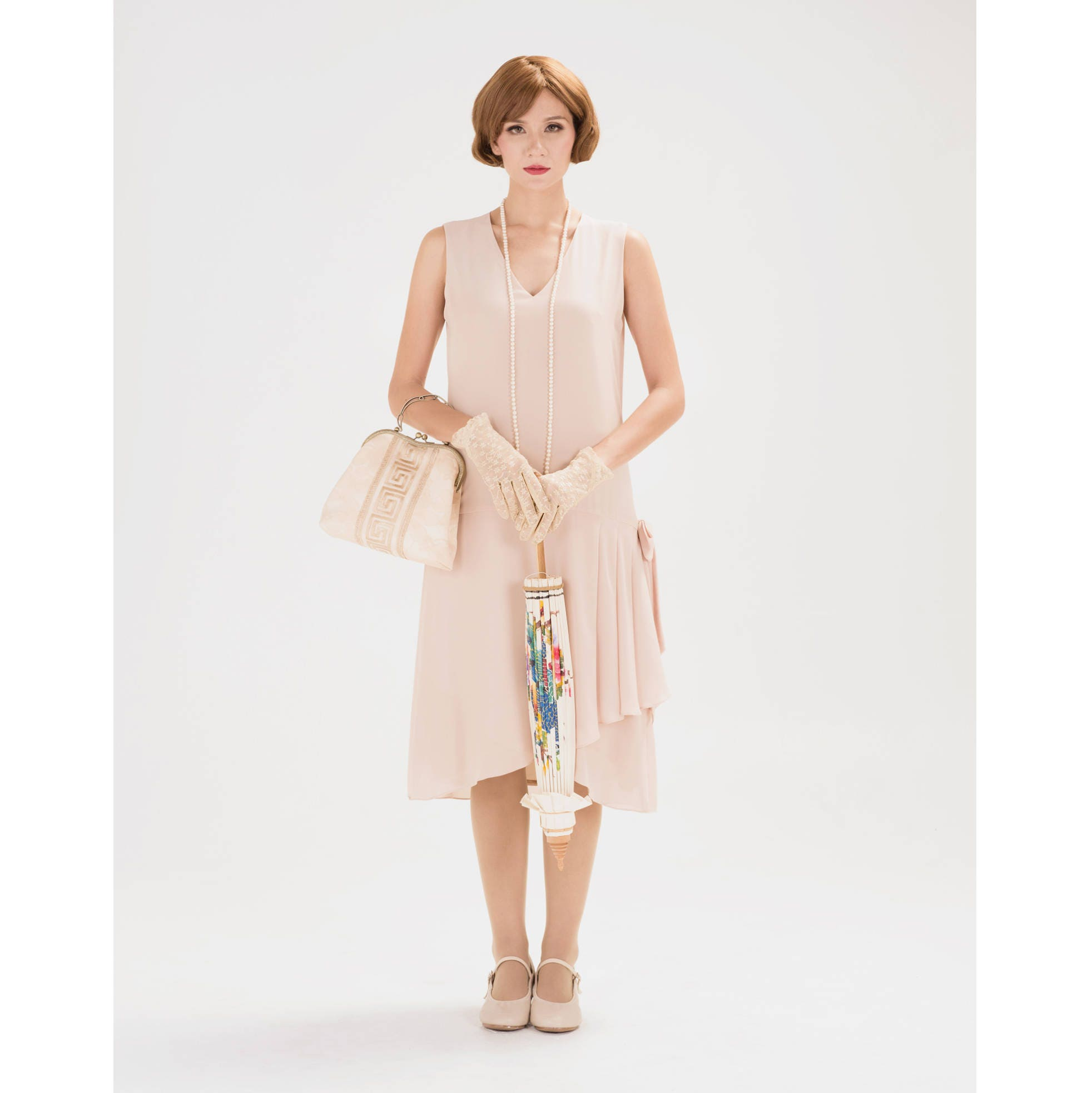 1920s flapper dress with drape and bow in nude color Great