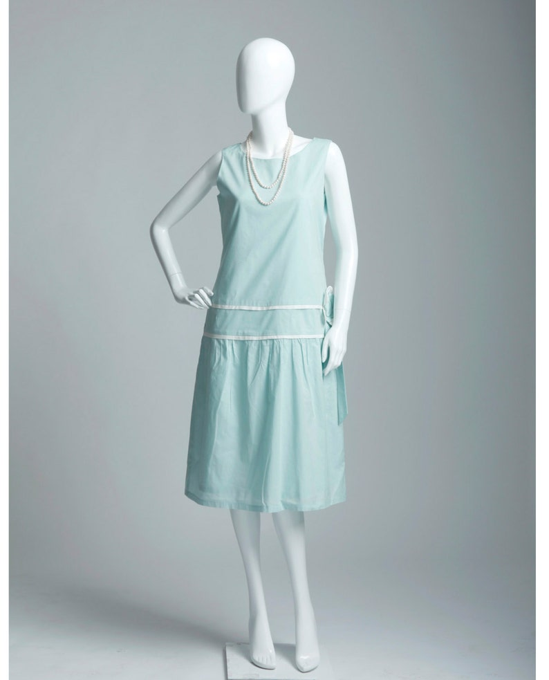 1920s Day Dresses, Tea Dresses, Mature Dresses with Sleeves Light seafoam green cotton flapper dress with flower bow cotton tea dress Great Gatsby daywear Downton Abbey dress 1920s cotton dress $130.00 AT vintagedancer.com