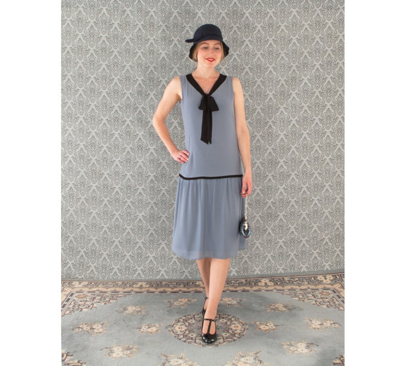 1920s Afternoon Dresses, White Tea Dresses Cute little flapper dress in grey and black bow 1920s flapper dress grey Great Gatsby dress 20s dress Charleston dress flapper outfit $130.00 AT vintagedancer.com