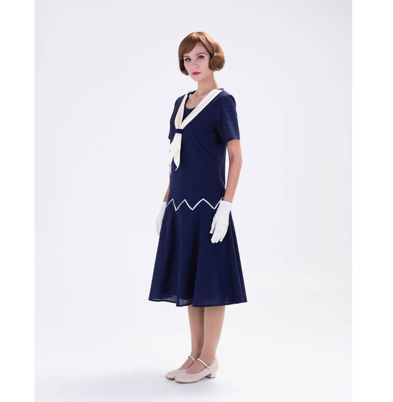 99049d173f5 1920s inspired dress in navy blue and white Great Gatsby
