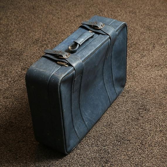 Vintage blue suitcase, vintage luggage, retro suit