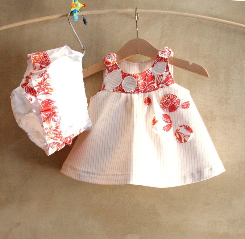 Abito neonata in cotone bianco e arancione vestito e  b84a336ab6e