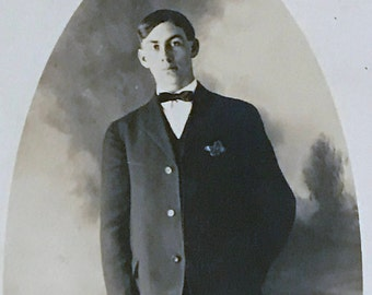 Antique 1900s Portrait RPPC, Handsome Young Gentleman with Bow Tie, Unused, Pre Linen, Divided Back Postcard