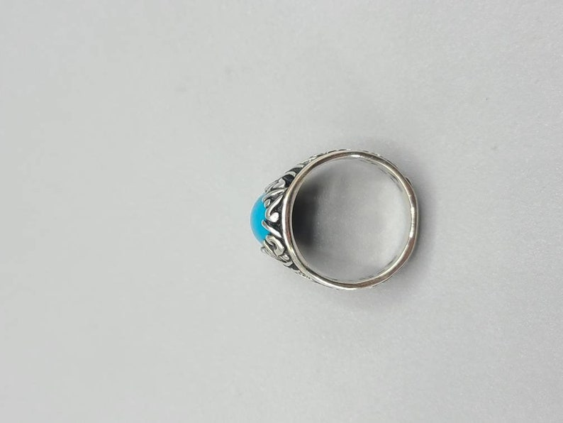 Designer Relios Turquoise Oblong open work ring Set in 925 Silver size 7 Item w# 233
