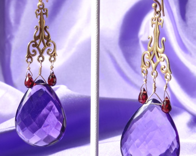 SHOW STOPPING AMETHYST earrings.Large amythist drops hang from prettyvermeil chandellers with small fauceted garnet briolets.
