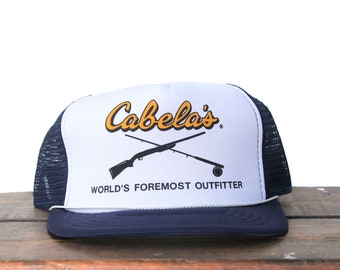 1c3f396b5ff00 Vintage Cabelas World s Foremost Outfitters Hunting Fishing Outdoor  Supplies Trucker Hat Snapback Baseball Cap